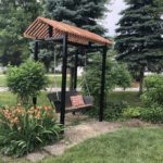 Featuring black powder coated posts and capped-top with custom swing.